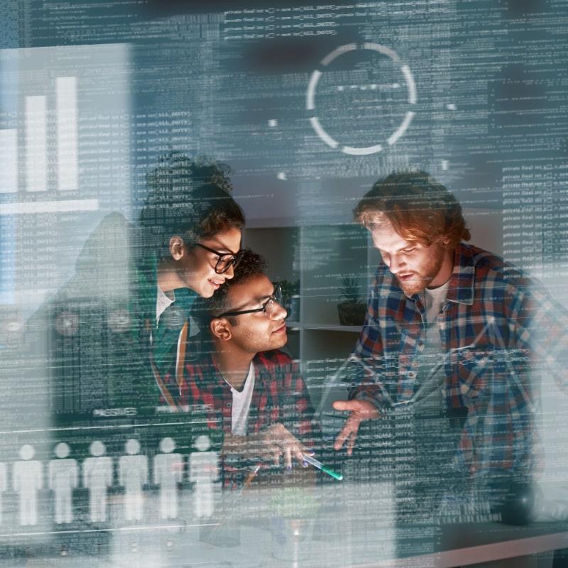 Three people talking behind glass