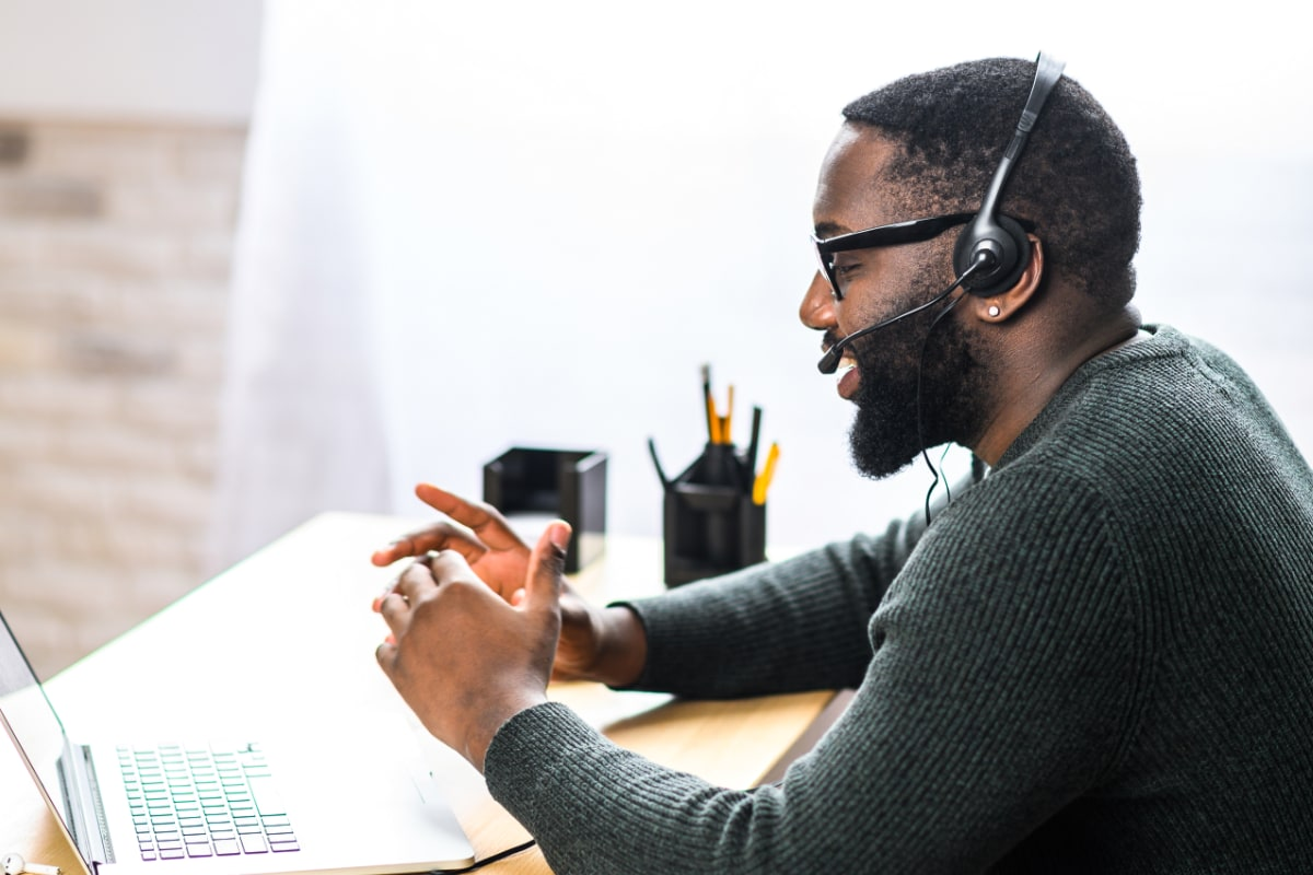 Business man with a headset and computer talking on the phone