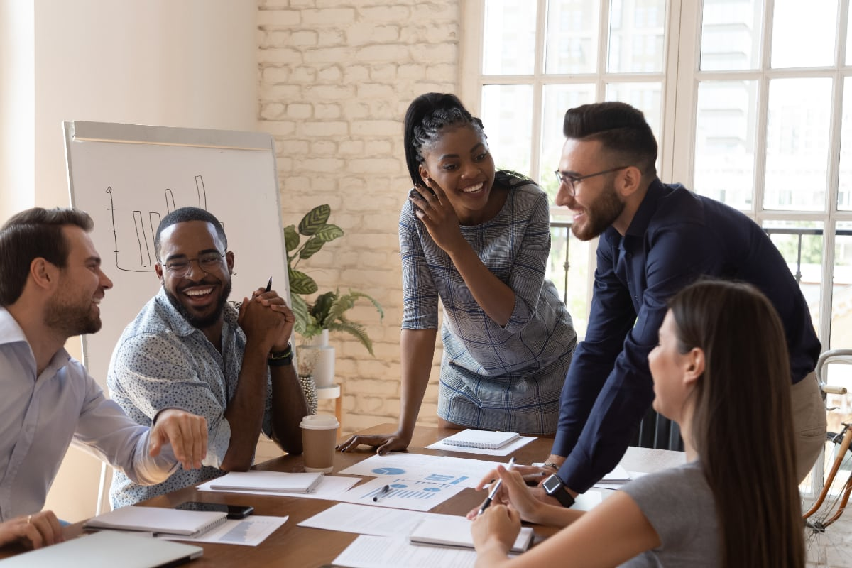 Group of young professionals at conference table talking