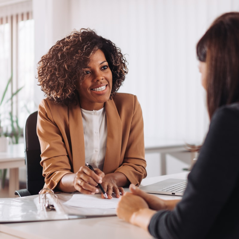 A woman interviewing someone for a job